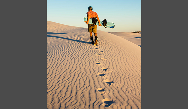 Man walking with sandboard