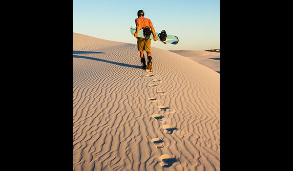 Man walking with sandboard