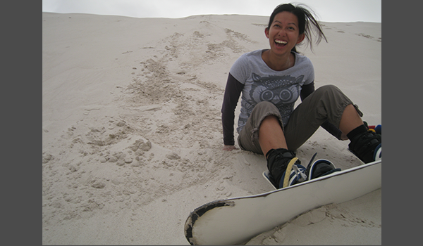 Happy lady sandboarding