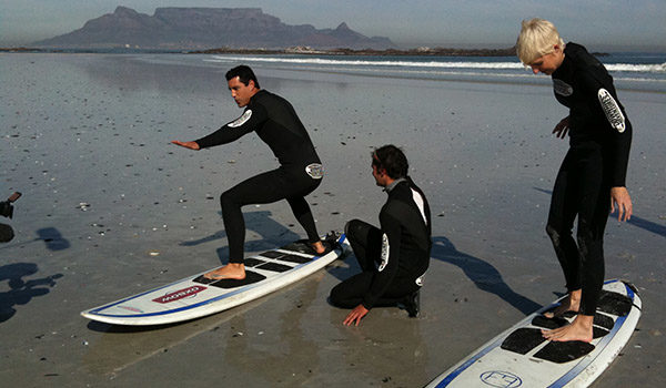 Surfers with instructor