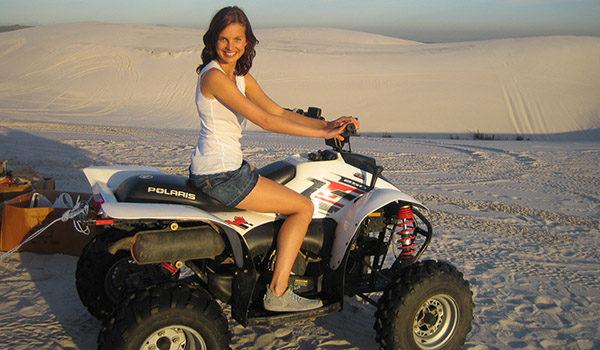 Lady posing on quabike