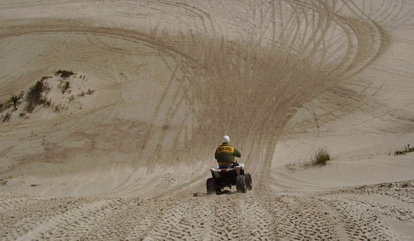 Man going downhill on quadbike