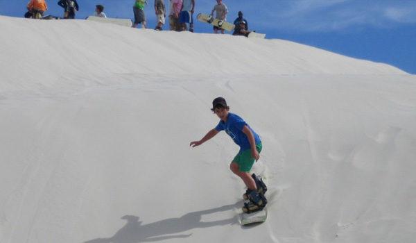 Boy Sandboarding